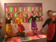From left: Roni Matilac, Hannah Wadi, Cay Wadi dance with Teacher Ligaya Amilbangsa with the pangalay silhouettes of Ligaya at the background.