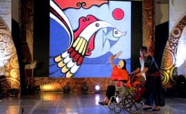 Ligaya Amilbangsa performs seated on a wheelchair.