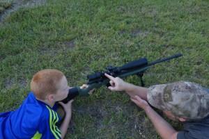 Sam showing Jake how to use the scope level