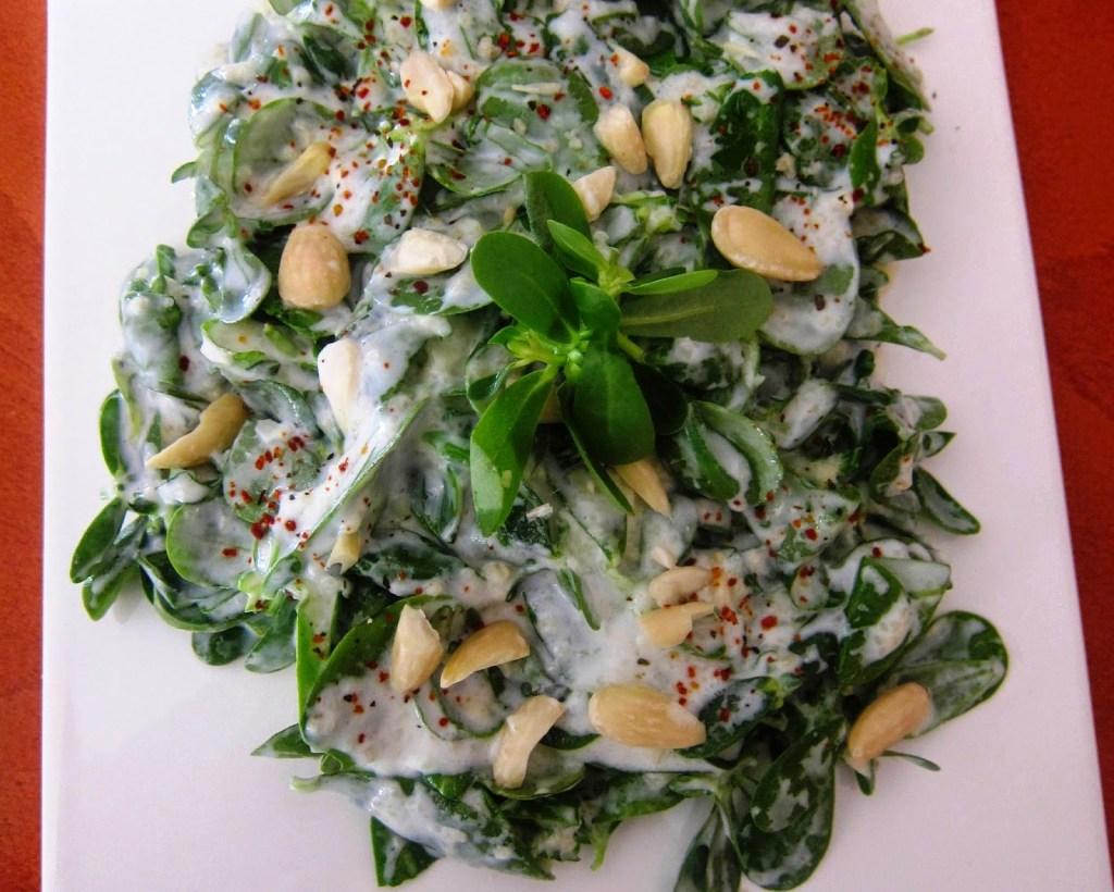 Purslane salad with yogurt and almonds
