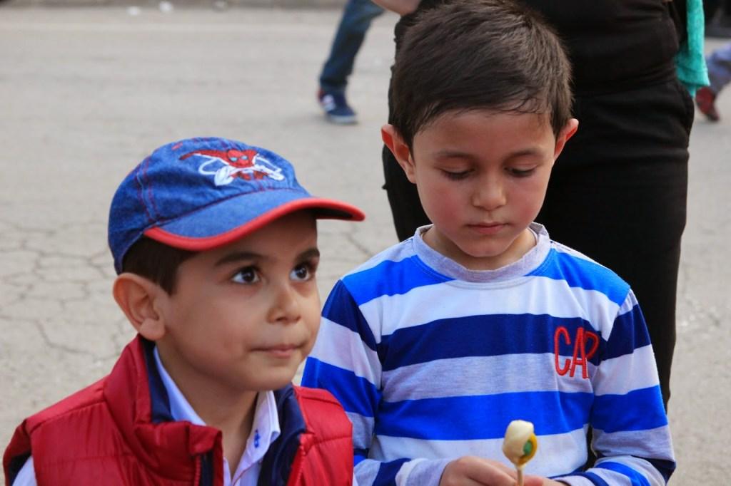 Children watching lollypop making
