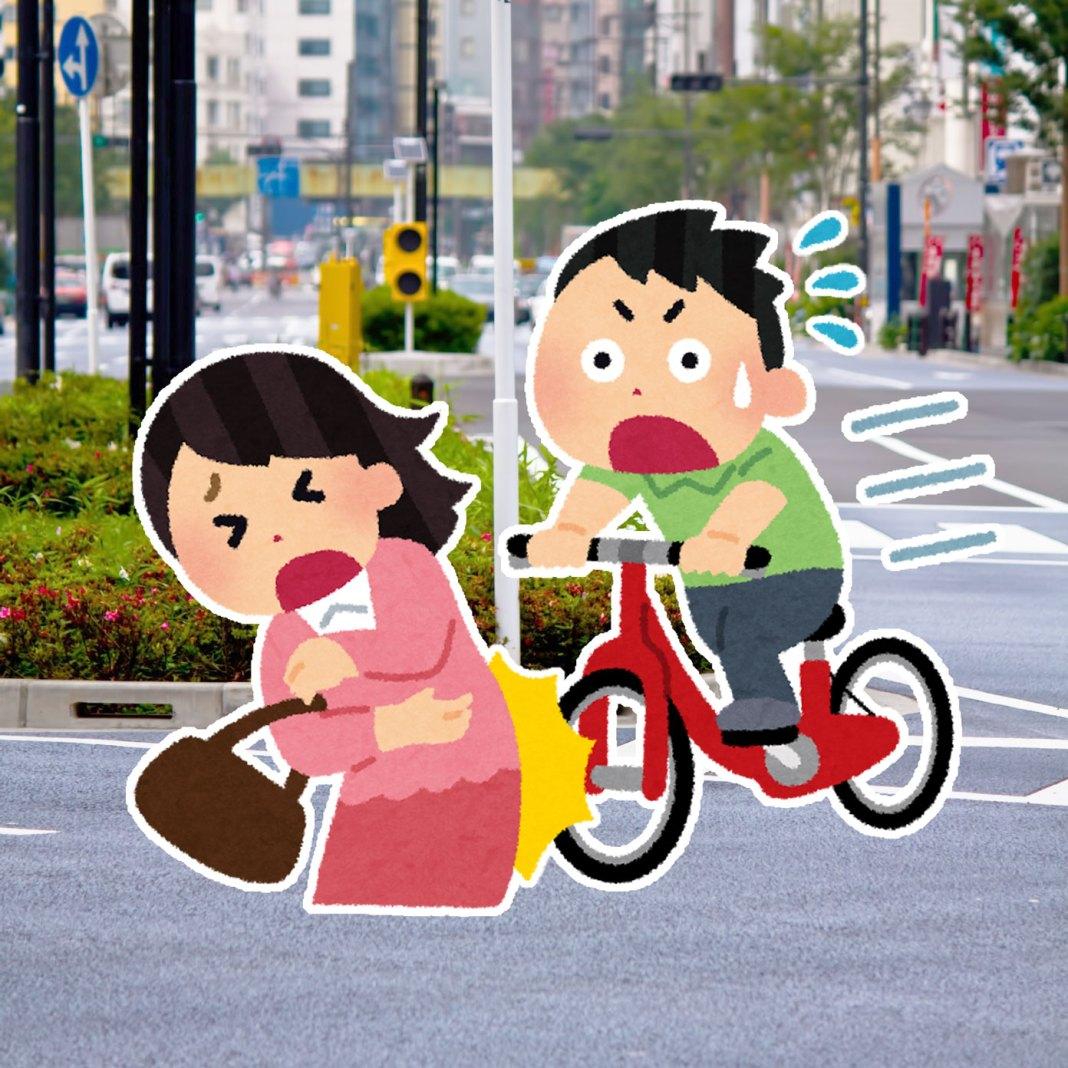 路上で自転車事故。自転車に乗る男性が歩行中の女性に激突