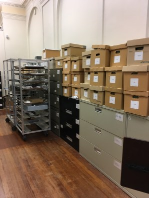 Previous arrangement of the archives area: mostly filing cabinets and boxes piled on top.