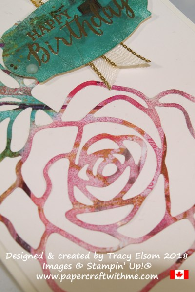 Close up of paper die-cut from a magazine and coloured with ink using a sponge dauber. www.papercraftwithme.com