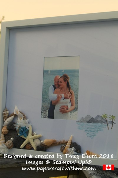 Beach wedding photo frame created using the Waterfront Stamp Set from Stampin' Up!, with shell, pearls and silk flower embellishment from the bride's bouquet, and lava rock from the beach.