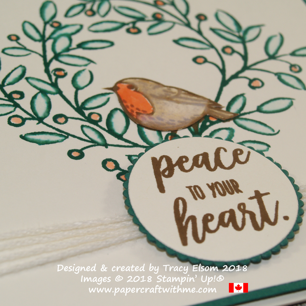 Close up of wreath, robin and peace to your heart sentiment created using the Feathers & Frost Stamp Set from Stampin' Up!