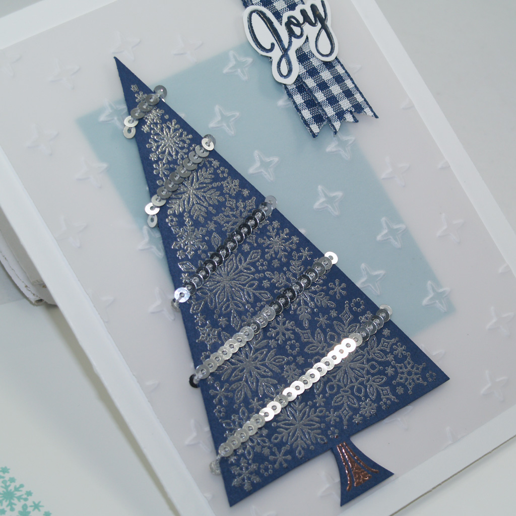 Close up of Christmas card with a silver embossed snowflake tree image and sentiment from the Snow is Glistening Stamp Set from Stampin' Up!