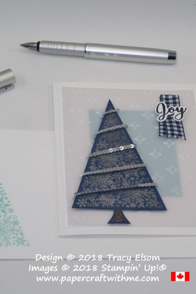 Christmas card with a silver embossed snowflake tree image and sentiment from the Snow is Glistening Stamp Set, part of the limited edition Snowflake Showcase suite of products from Stampin' Up!