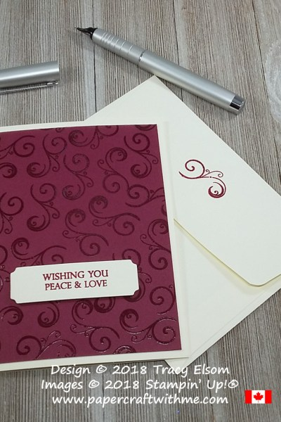 Clear embossed card with decorative element and peace & love sentiment from the Merry Christmas To All Stamp Set from Stampin' Up!