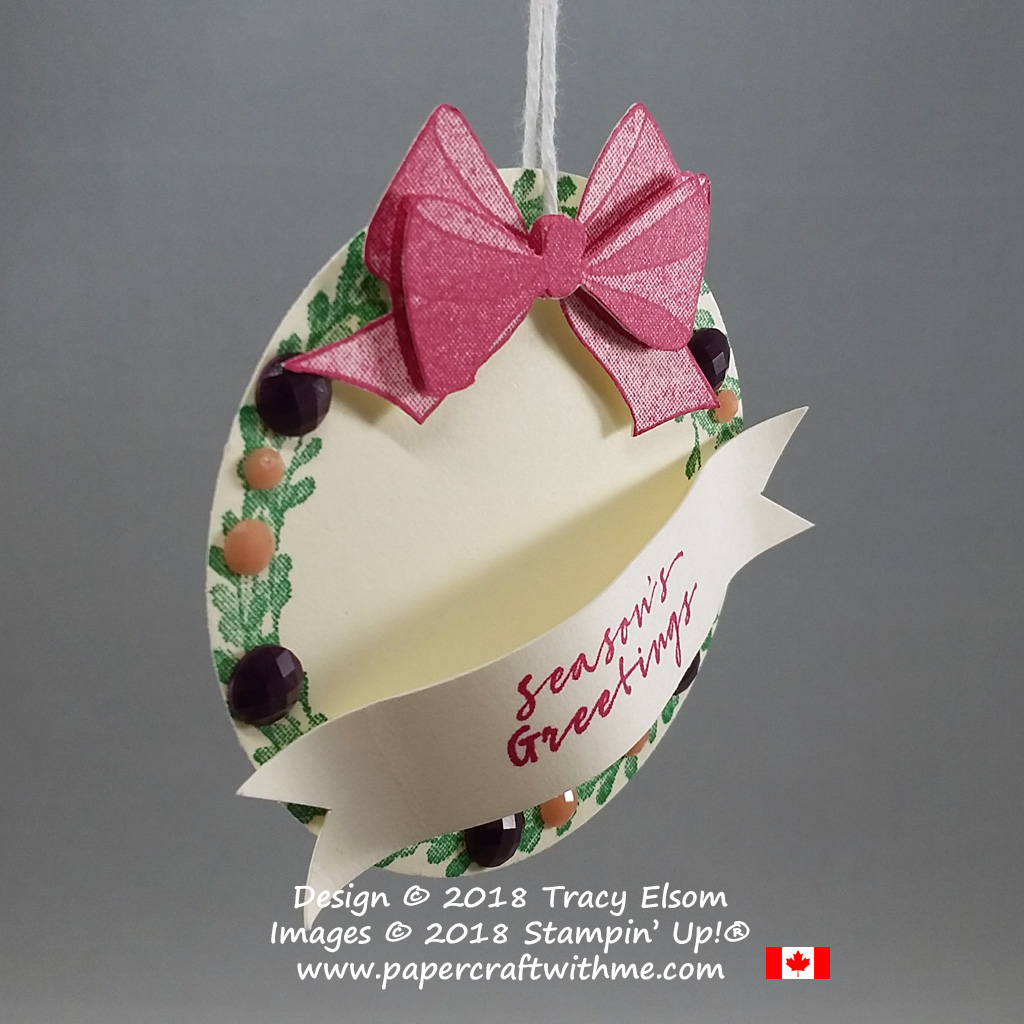 A layered gift tag with wreath and bow images from the Wishing You Well Stamp Set from Stampin' Up
