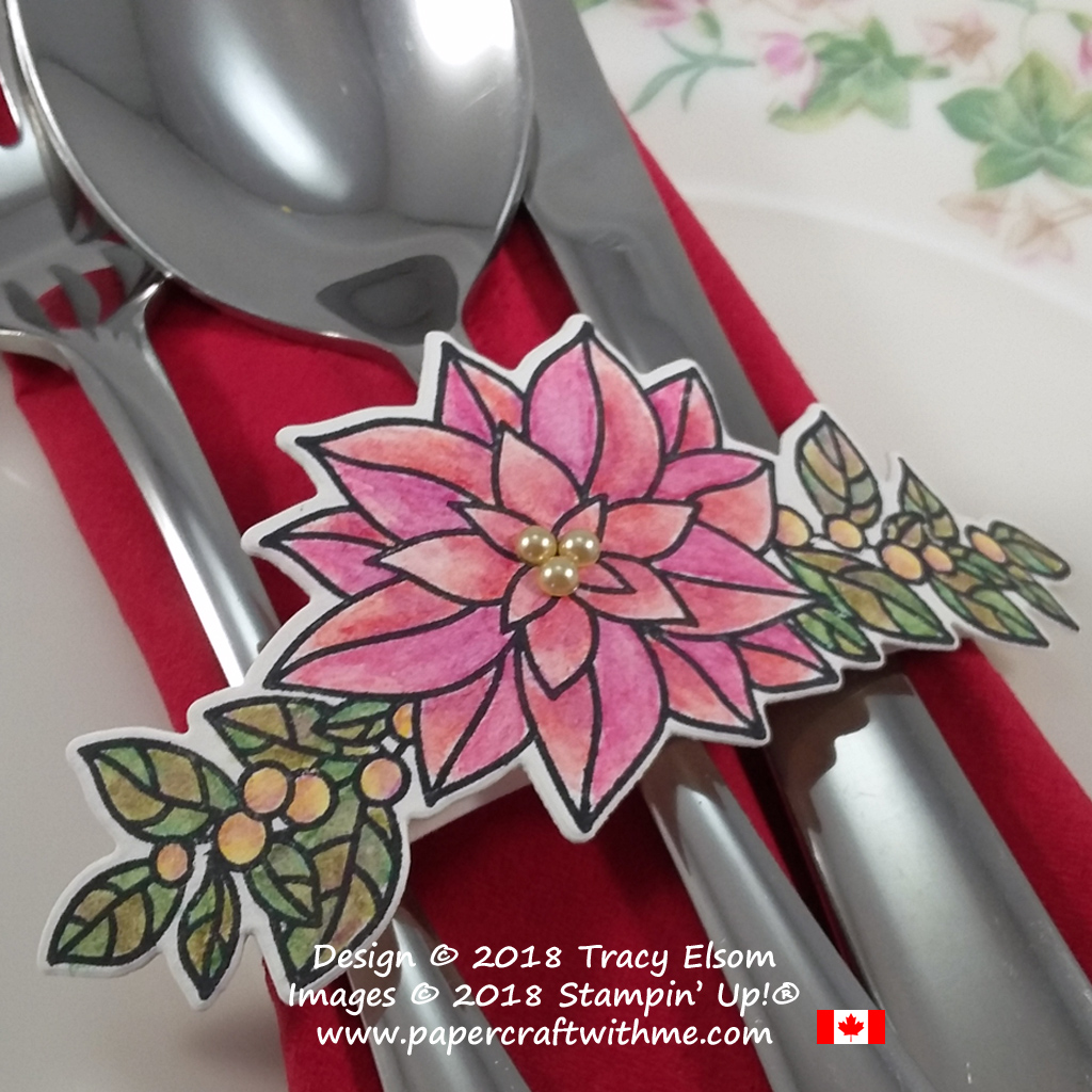 Close Up of watercoloured silverware wrap created using the Peaceful Poinsettia Stamp Set from Stampin' Up!
