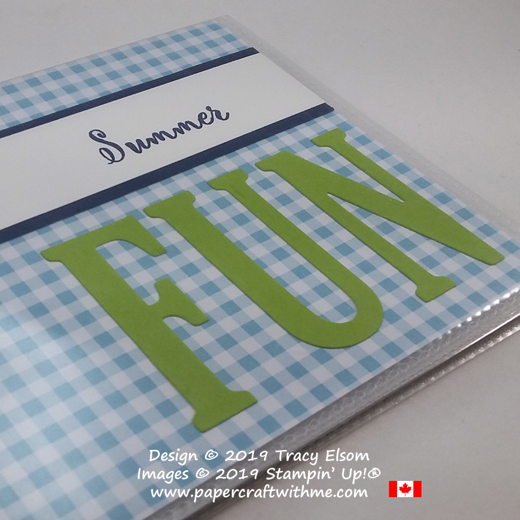 Close up of pocket photo album showing simple summer fun cover created using the Make a Difference Stamp Set and Large Letters Framelits on a gingham background, all from Stampin' Up!