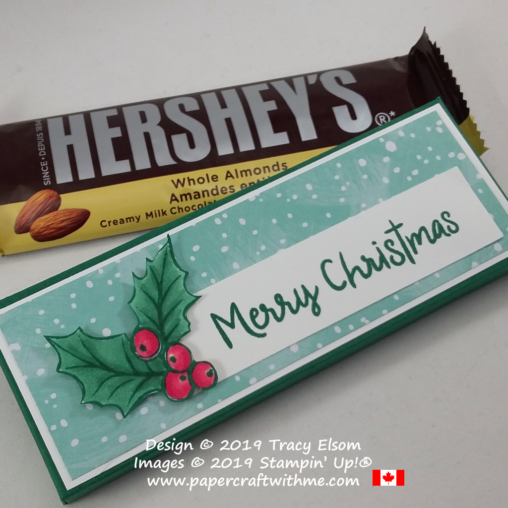 """Close up of handmade box for a Hershey's chocolate bar decorated using a holly image and """"Merry Christmas"""" sentiment from the Christmas Gleaming and Snowman Season Stamp Sets from Stampin' Up! #papercraftwithme"""