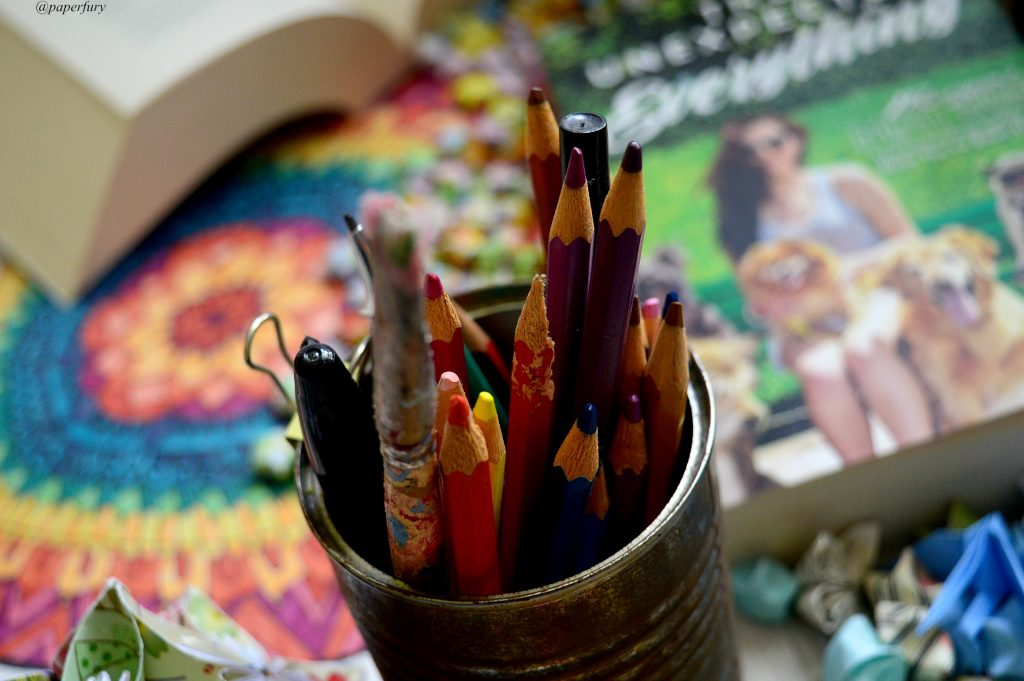 tin of pencils and books