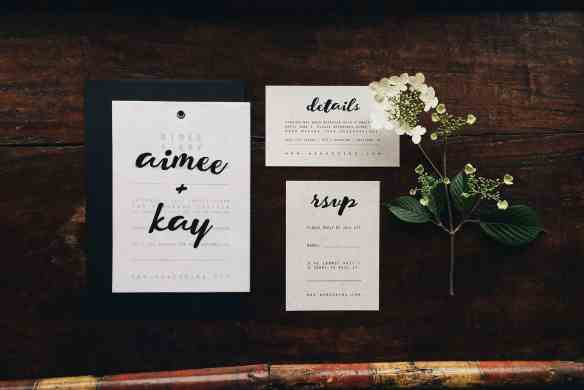 This modern minimalist wedding suite features black brush calligraphy and vellum paper. Designed by Emily Small for Paperjam Press in Portland, Oregon