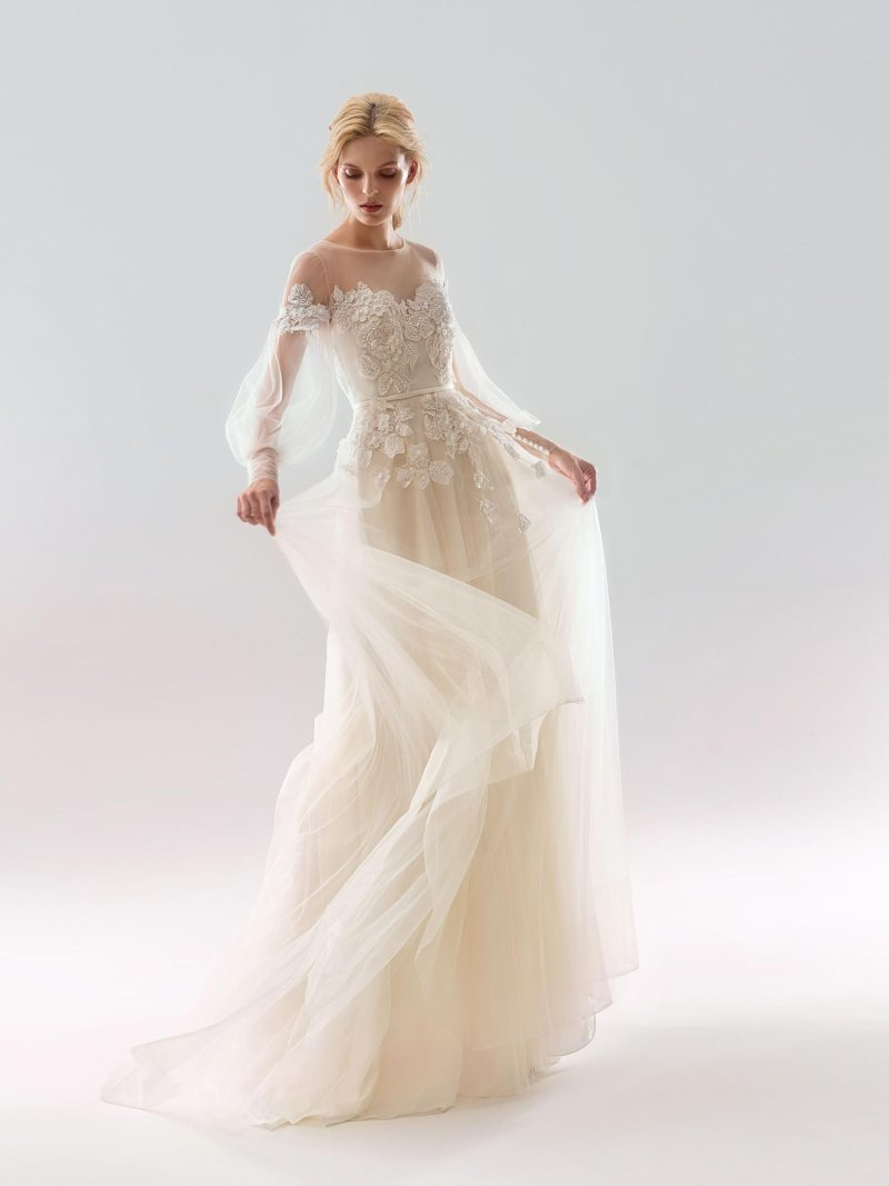 Dramatic off the shoulder A-line wedding dress with bishop sleeves