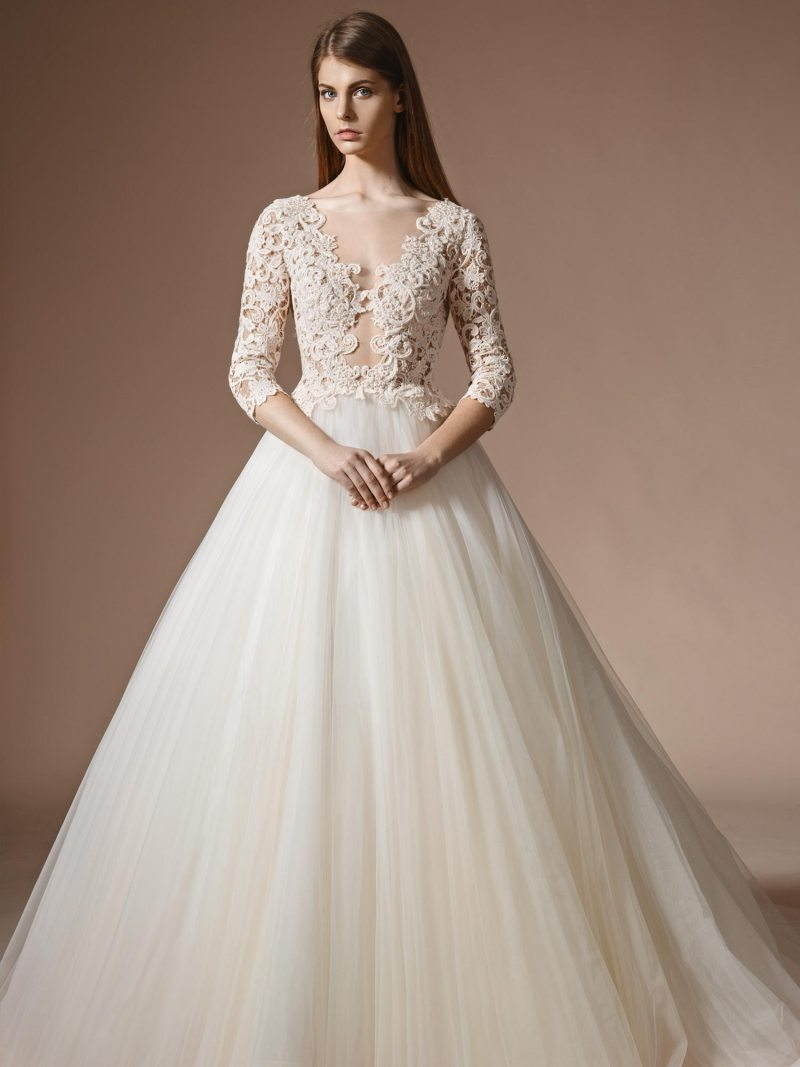 Lace bodice ball gown wedding dress with three-quarter sleeves