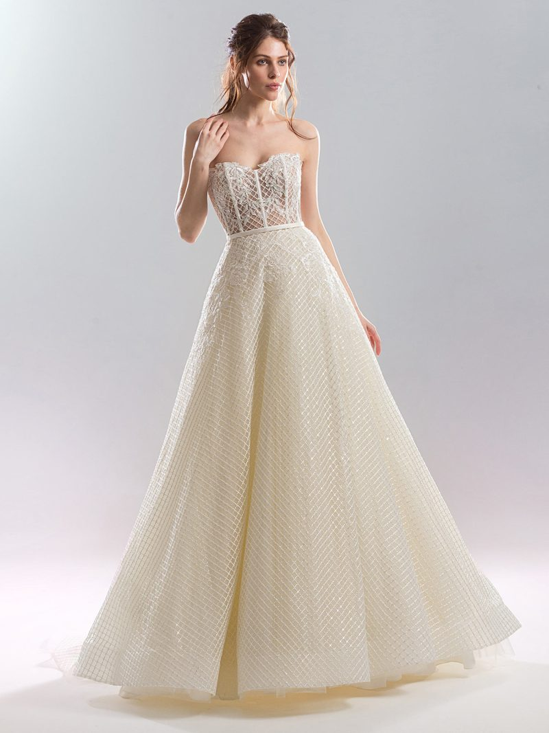 Strapless A-line wedding gown with a sheer bodice and sequined fabric