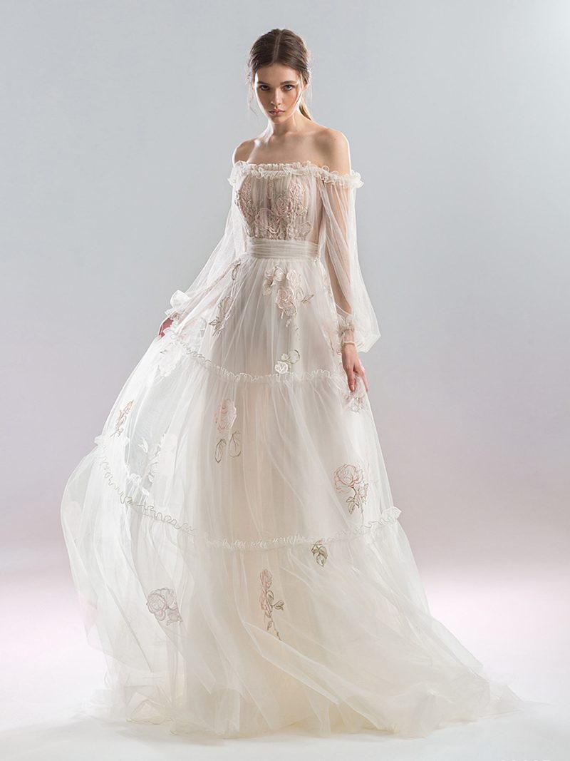 Off the shoulder A-line wedding dress with floral applique and bishop sleeves