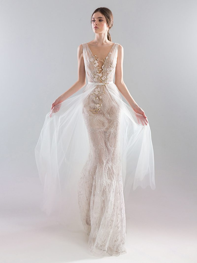 Fitted sheer lace wedding gown with deep v neckline and floral embroidery