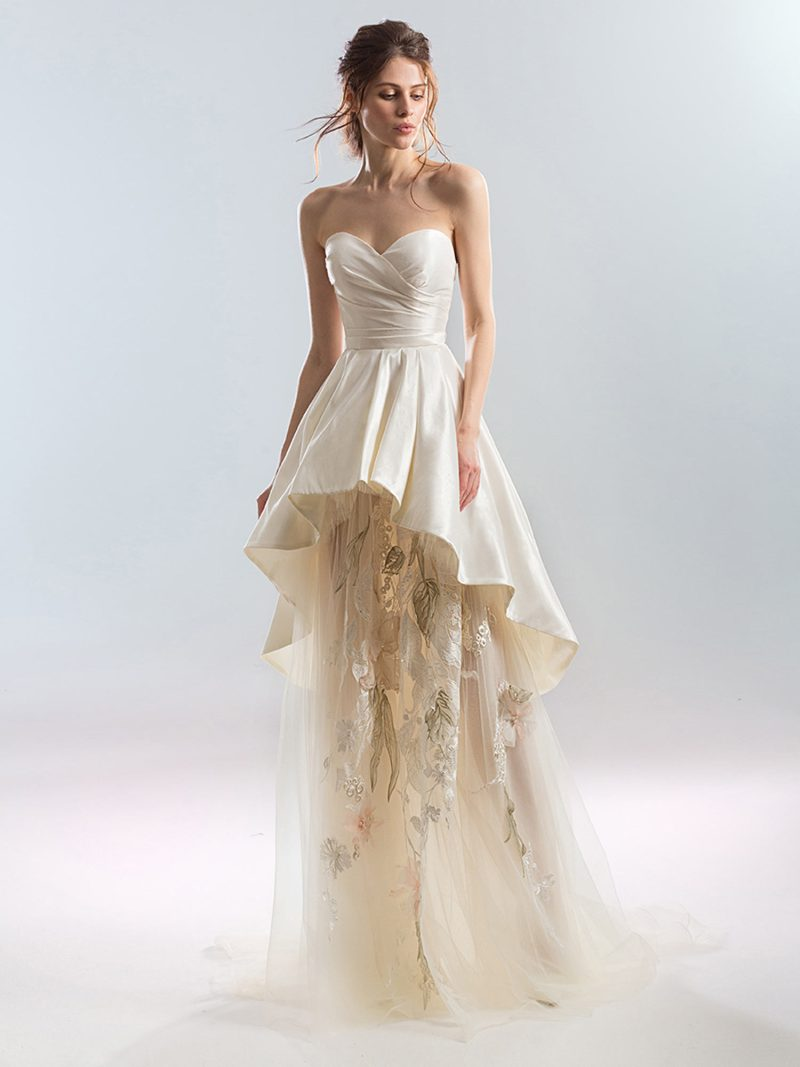 Strapless sweetheart A-line wedding dress with peplum layer and tulle skirt