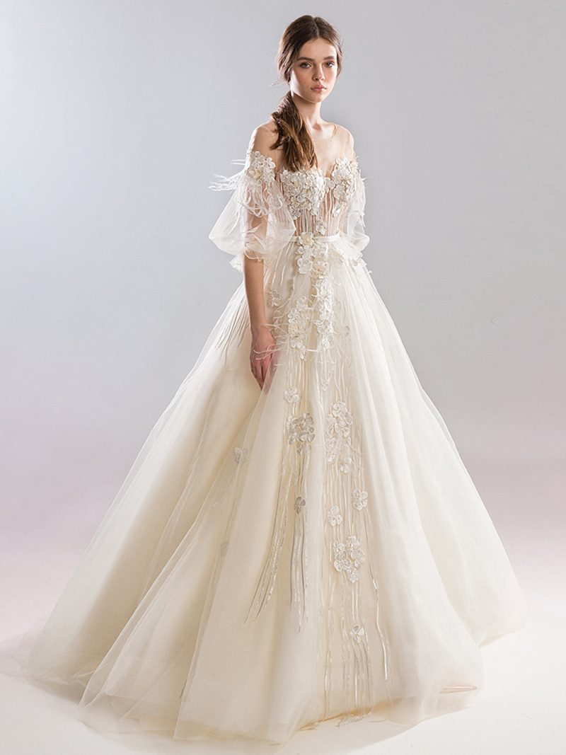 Dramatic ball gown wedding dress with bishop sleeves and embroidery