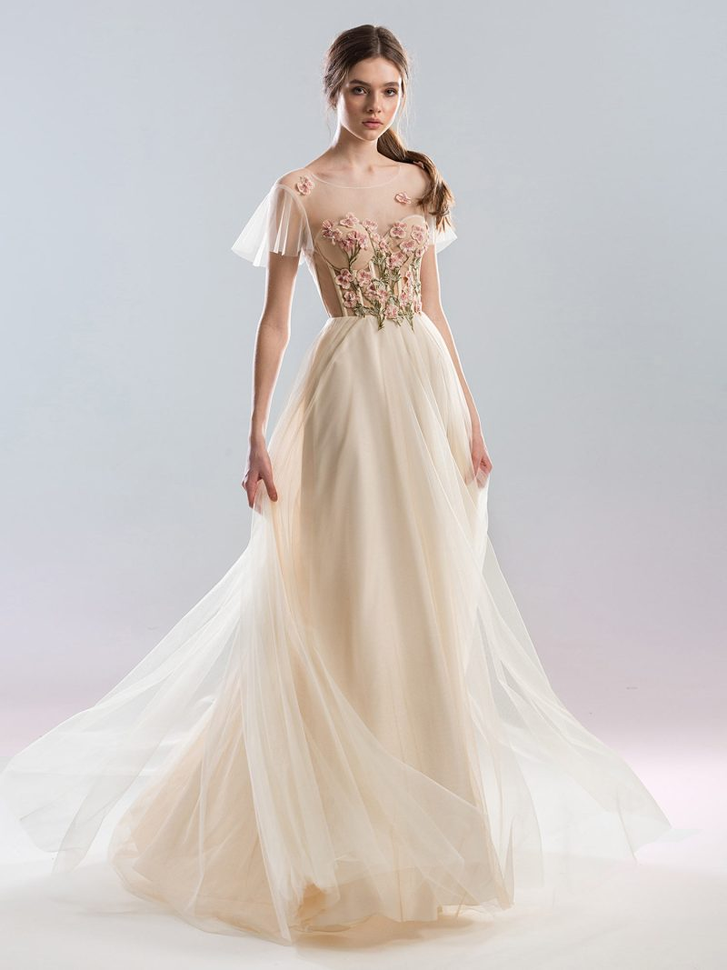 Cap sleeved wedding gown with tulle skirt and floral details