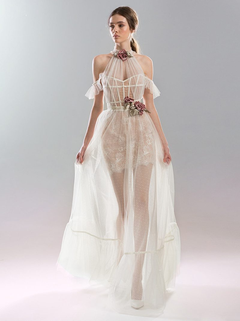 A-line floor length wedding gown with sheer overlay and cold shoulder
