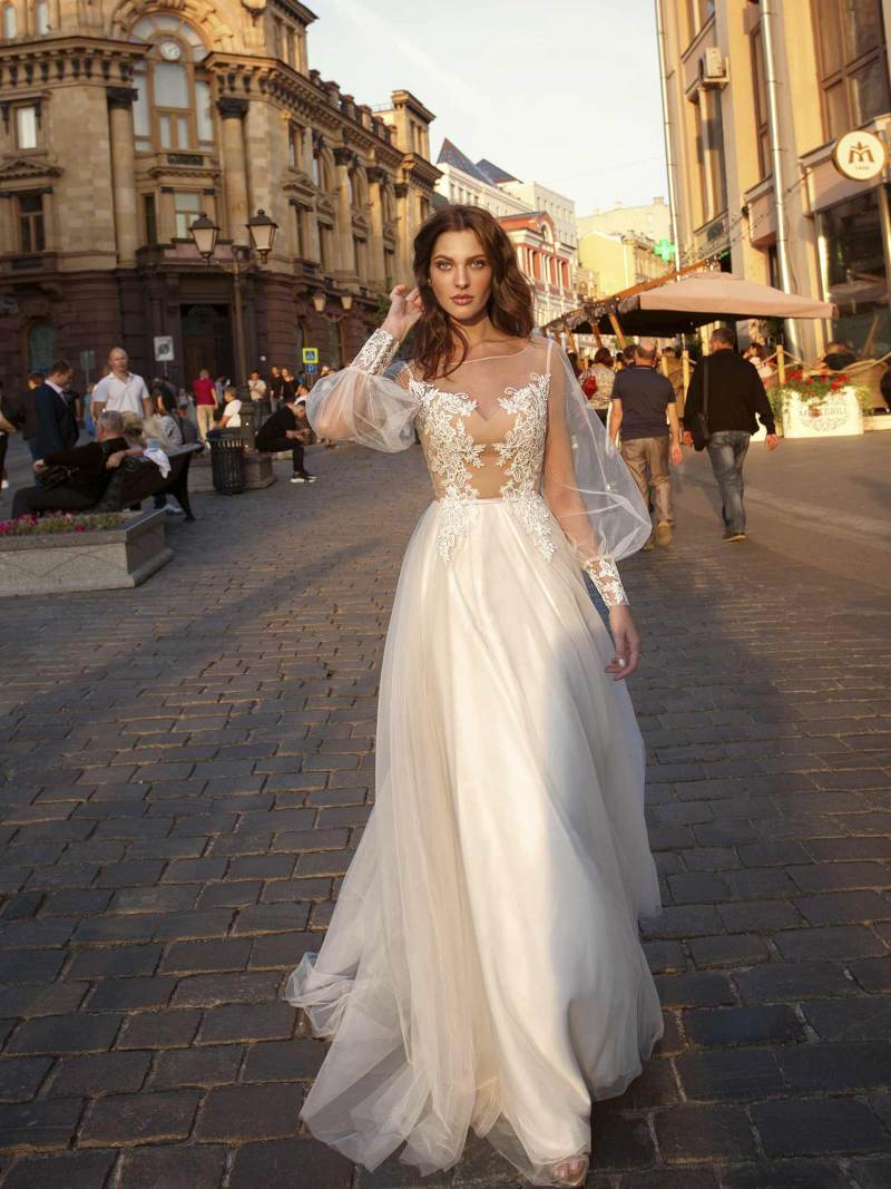 Bishop sleeve A-line wedding dress with illusion neckline and lace detailing on the bodice