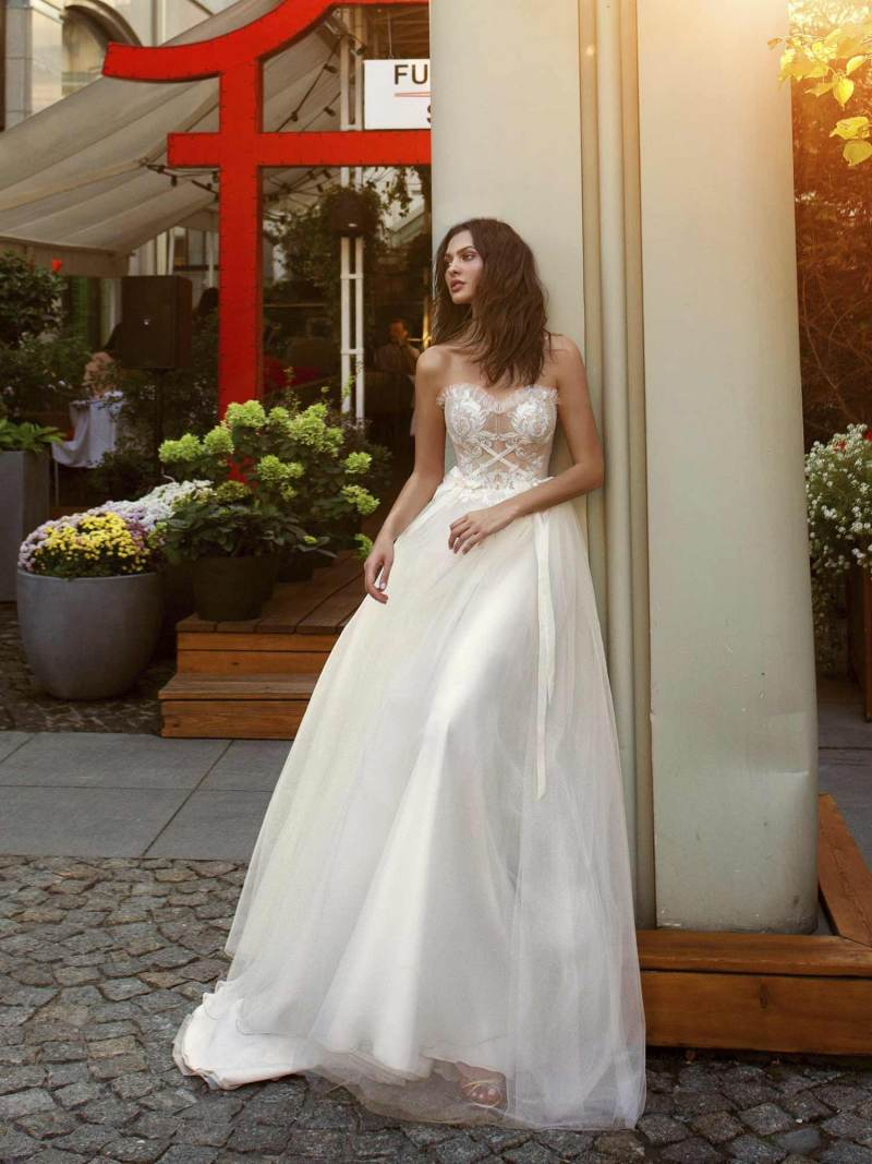 A-line wedding gown with a nude sweetheart bodice and ivory embroidery