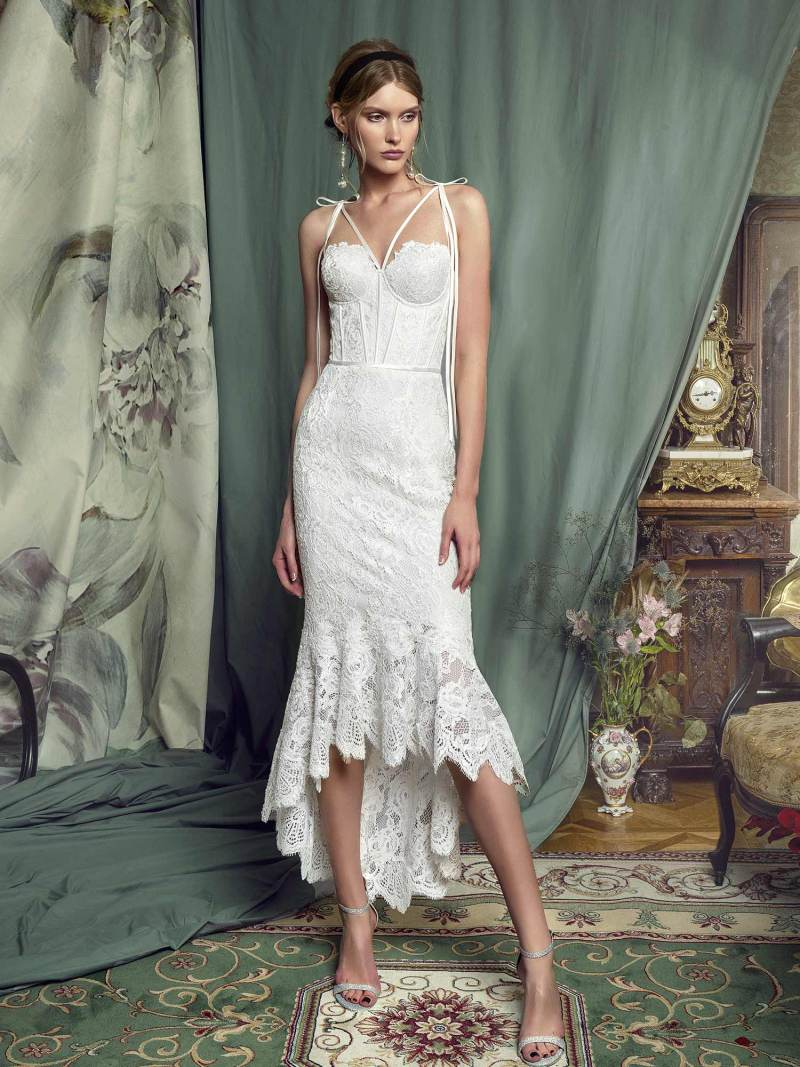 High-low lace mermaid gown with a bustier bodice