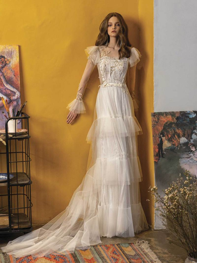 Wedding dress with long sleeves and ruffled skirt