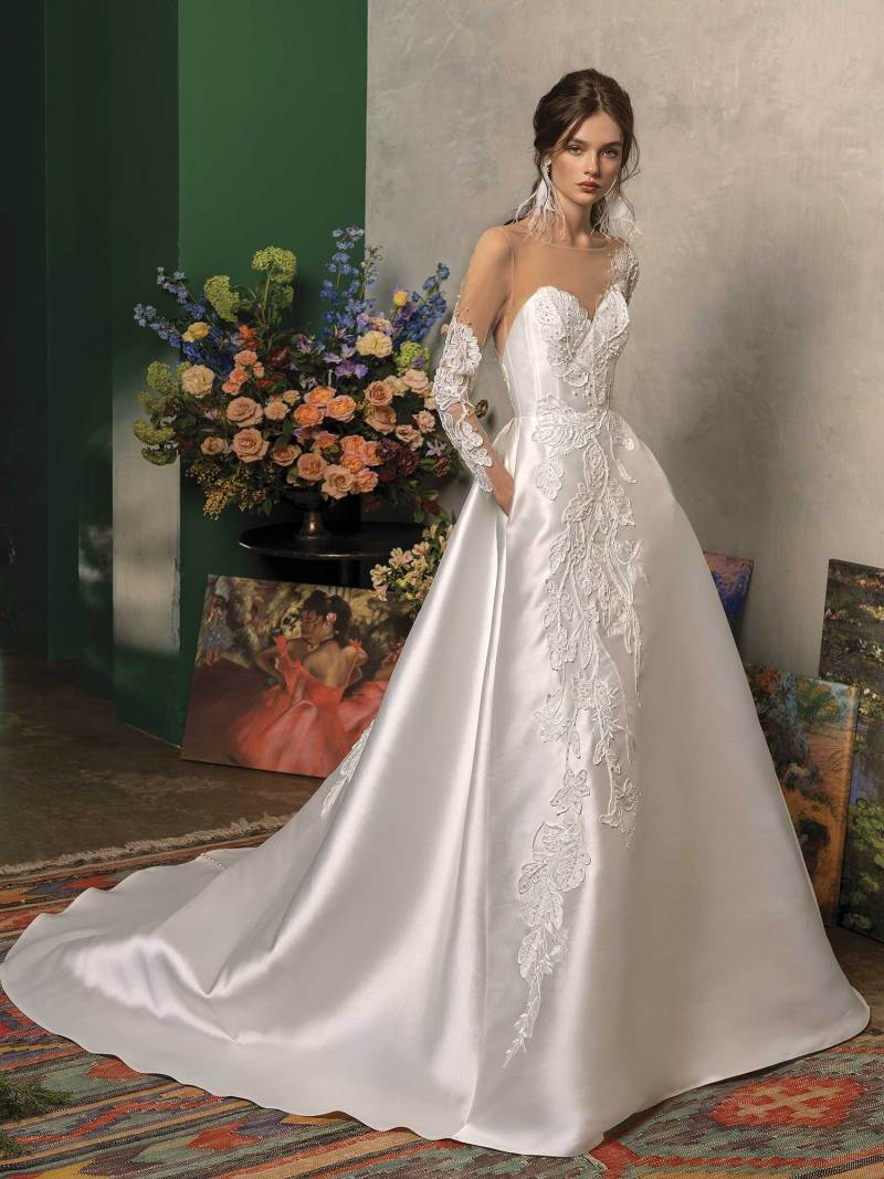 Long sleeved ball gown wedding dress with pockets