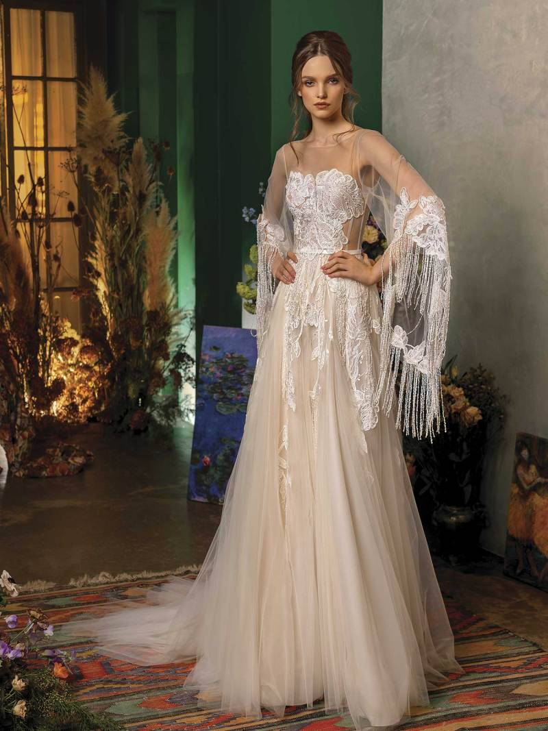 A-line wedding dress with trumpet sleeves and fringe