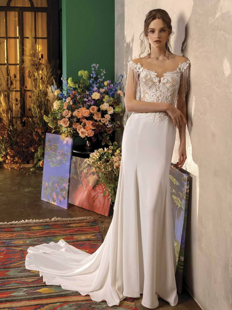 Fit and flare wedding dress with fringe