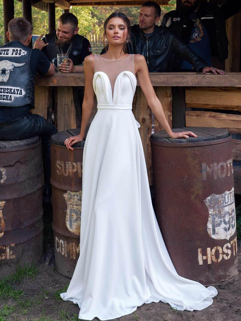 Simple wedding dress with plunging neckline