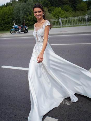 Bridal gown with cap sleeves and embroidery