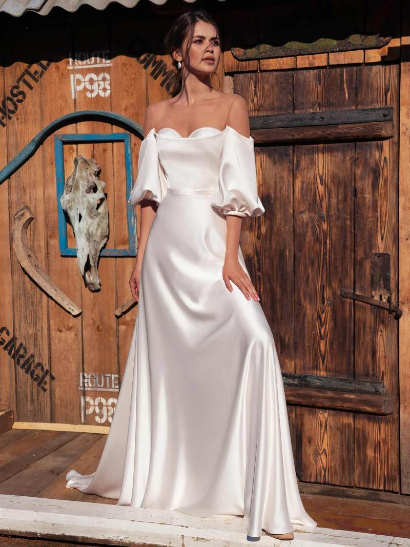 Off-the-shoulder wedding dress with bishop sleeves