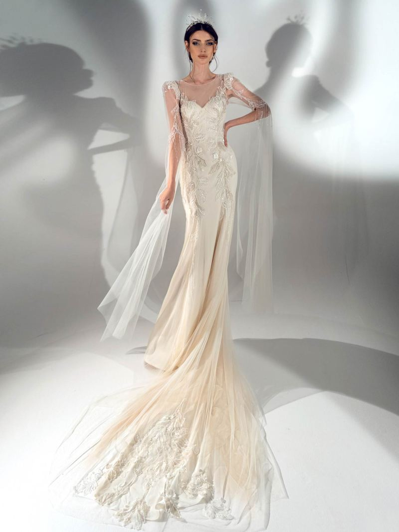 Fit and flare wedding dress with long bell sleeves
