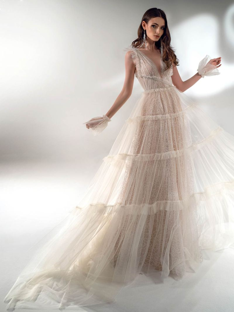 Shimmering A-line wedding dress with ruffles