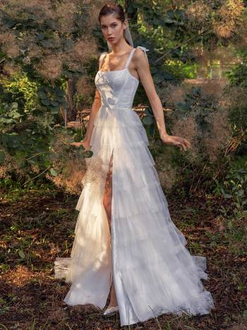 Shimmering ball gown with textured skirt and high slit