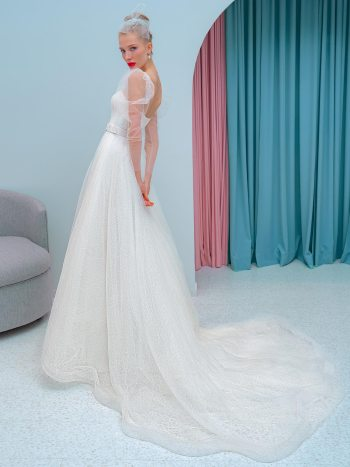 A-line wedding dress with plunging neckline and long sleeves