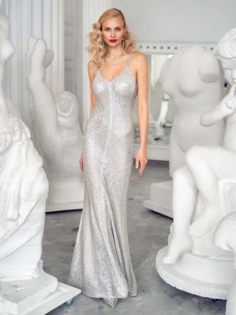 Fitted gown with spaghetti straps and open back