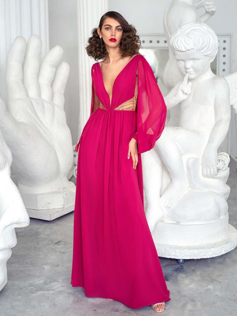 Long-sleeve evening gown with plunging neckline and illusion side cutouts