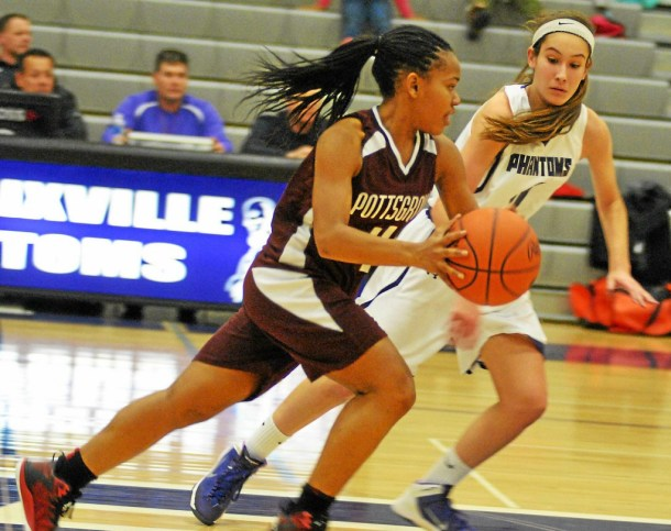 Barry Taglieber - For The Phoenix Pottsgrove's Diana Randleman dribbles upcourt while being guarded by Phoenixville's Dakota Graham.