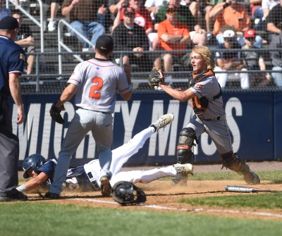 Marple Newtown catcher Brian Protesto tags out a Council Rock North runner at home plate as pitcher Ricky Collings awaits the call. Collings was masterful in pitching the Tigers to a 3-1 win in Thursday's PIAA Class AAAA quarterfinal. (Digital First Media/Pete Bannan)