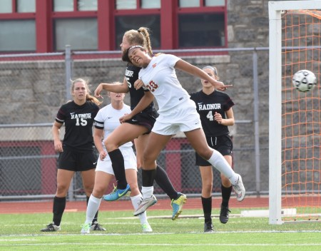 Haverford's Brianna Blair, right, leaping against Radnor's Allison Lanzone in a recent game, is part of a staunch Haverford defense that has them flying high in a crowded Central League. (Digital First Media/Anne Neborak)