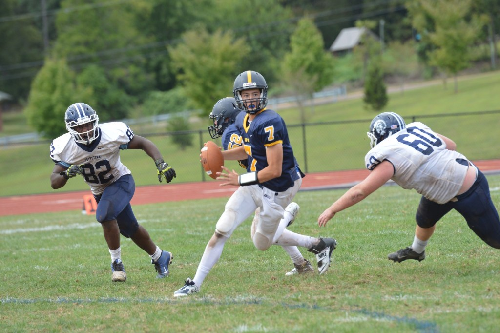 Pope John Paul II's Matt DeLaurentis scrambles for a first down during the Golden Panthers' 20-6 victory over Pottstown. (Sam Stewart - Digital First Media)