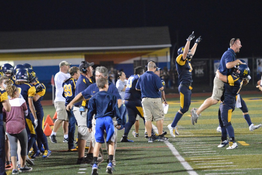 Upper Perkiomen's sideline celebrates after Josh Felbinger's recovery on a squib kick sealed the deal for the Indians in a 47-35 victory over Phoenixville Friday. (Sam Stewart - Digital First Media)
