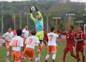 Perk Valley keeper Andrew Daubenspeck leaps to catch a corner kick against OJR. (Austin Hertzog- DFM)